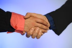 Handshake. Of two business people isolated on background Royalty Free Stock Image