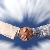 Handshake. Against the blue sky Stock Photo