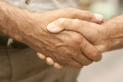 Handshake. Two old guy are shaking hands Stock Photo