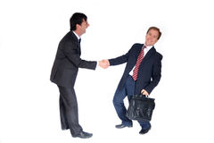Handshake. Isolated white background, two business man shaking hands and laughing Royalty Free Stock Image