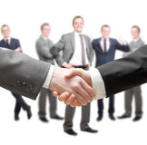 Handshake. Businessmen in a group and a handshake royalty free stock photography