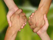 Handshake. 2 Hand shakes in green bg Royalty Free Stock Photography