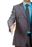 Handshake. Well-dressed business man is giving a handshake with an open hand ready to seal a deal, isolated over white stock photography