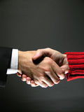 Handshake 2. Agreement on a yellow background. May fit a CEO to employee or business to end user concept stock photo