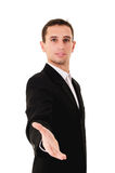 Handshake. Happy young businessman ready to seal a deal stock image