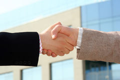 Handshake. Two businessmen shaking hands after agreement about a job Royalty Free Stock Image