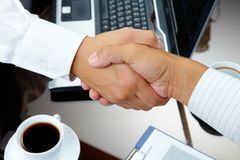 Handshake. Photo of handshake of business partners after striking deal royalty free stock photos