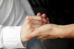 Handshake. Pulling the hand neighbor Royalty Free Stock Photography