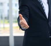Handshake. A business man with an open hand ready to seal a deal Royalty Free Stock Photography