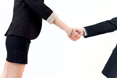 Handshake. Between business women and men on white background stock image