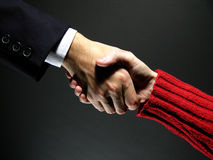 Handshake 3. Agreement on a yellow background. May fit a CEO to employee or business to end user concept stock photography