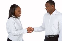 Handshake. African-American businesswoman shakes hands with businessman Royalty Free Stock Image