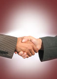 Handshake. Business handshake with red background Royalty Free Stock Photos