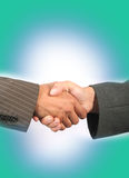 Handshake. Business handshake with green background Royalty Free Stock Photo