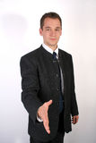 Handshake. A young businessman ready to handshake Stock Image