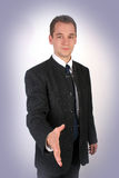 Handshake. A young businessman ready to handshake Royalty Free Stock Image