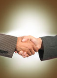 Handshake. Business handshake with colour background Stock Photography
