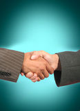 Handshake. Business handshake with greenly background Royalty Free Stock Photo