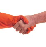 Handshake. With one hand in the latex glove Royalty Free Stock Photos