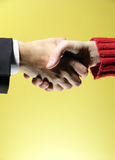 Handshake 4. Agreement on a yellow background. May fit a CEO to employee or business to end user concept stock images