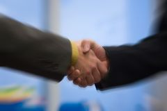 Handshake. Two business men close a deal royalty free stock photography