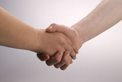 A handshake. Two men hand shake close up Stock Image