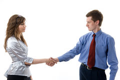 Handshake. The union of young business man and business woman. Isolated over white Royalty Free Stock Photo