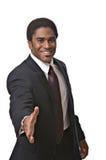 Handshake. A handsome African-American man extends a handshake stock image