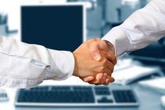 Handshake. A business handshake in office Stock Image