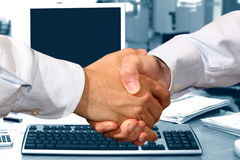 Handshake. A business handshake in office Royalty Free Stock Images