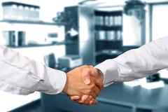 Handshake. A business handshake in office Stock Photos