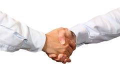 Handshake. A business handshake on white background Royalty Free Stock Image