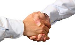Handshake. A business handshake on white background Stock Photo