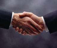 Handshake. Two men in business suits shaking hands Royalty Free Stock Photography