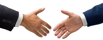 Handshake. Two hands reach after a handshake Royalty Free Stock Image