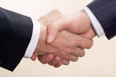 Handshake. One man shakes another man by the hand Royalty Free Stock Images