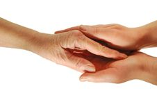 A handshake. Young hands hug a granny hand Stock Photo