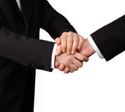 Handshake. Two businessman in suits give a handshake Royalty Free Stock Photography