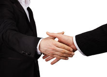 Handshake. Two businessman in suits give a handshake Stock Photos