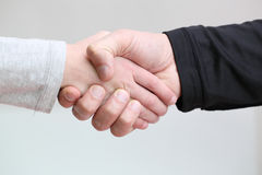 Handshake. Adult handshake father and little daughter Royalty Free Stock Image