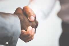 Handshake between african and a caucasian man Royalty Free Stock Photography