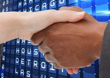 Handshake against flights posting royalty free stock images