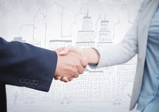 Handshake against white wall with city doodle Stock Photos