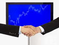 Handshake agreement investment in economic Stock Photos