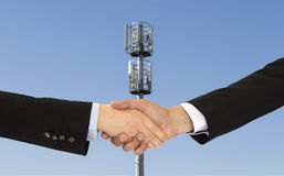 Handshake agreement telecom Stock Images