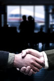 Handshake at the airport Royalty Free Stock Photos