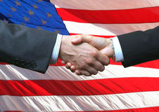 Handshake and American Flag Royalty Free Stock Images