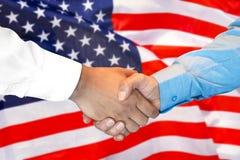 Handshake on american flag background royalty free stock photos