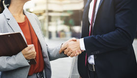 Handshake Analysing Collaboration Colleagues Concept. Business people Handshake Analysing Collaboration Colleagues Concept Royalty Free Stock Images