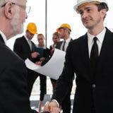 Handshake of architect and investor Stock Photos